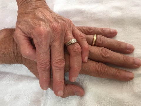 Old Hands with wedding rings on top of each other