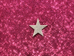 Gold star with pink sparkle background