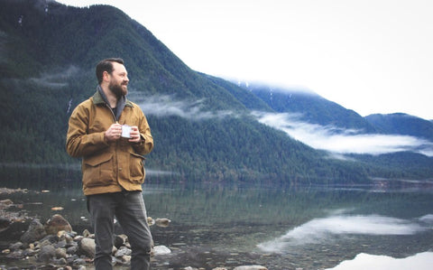 Man holding coffee looking at the Great Lakes