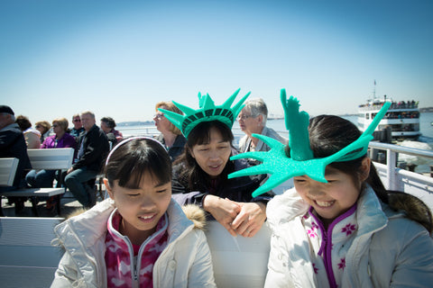 Family going to Ellis Island and the Statue of Liberty