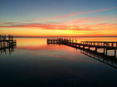 Beautiful orange and blue sunset on the coast of Outer Banks