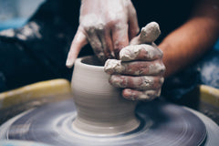 Close up image of pottery being made on a wheel