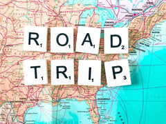 """""""Road Trips"""" letters on a United States map"""