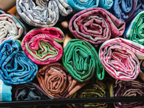Colorful rolled shirts in a suitcase