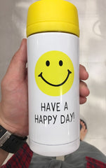 """""""have a happy day"""" decal on a tumbler cup"""
