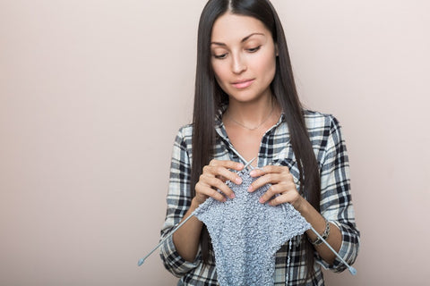 Woman knitting a hand crafted gift