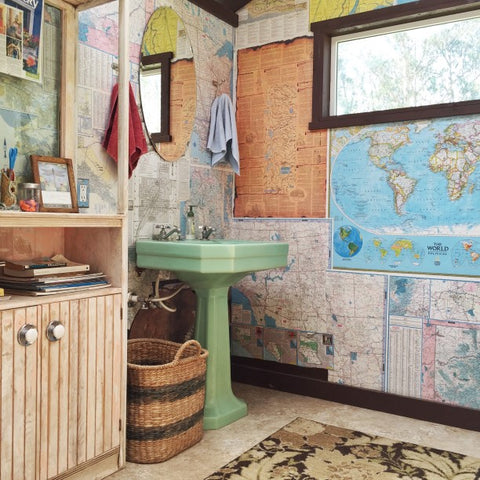 Bathroom with wood maps and lake art to decorate