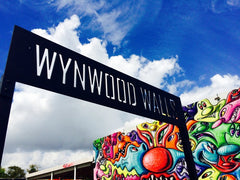 Wynwood Wall sign with painted walls in the background