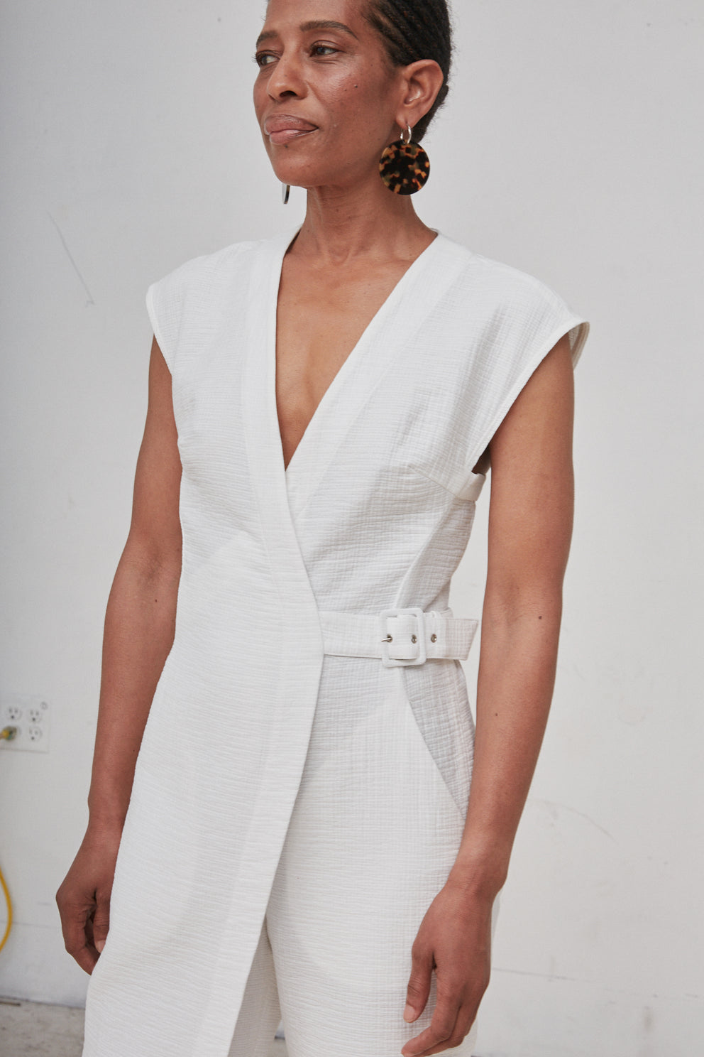 Giannie Couji wears Rachel Comey's Steadfast jumpsuit in white