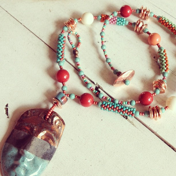 Red Cora, Ivory, and Coral Swarovski Pearls along with our Peyote Stitch beaded tubes make up this fun Necklace