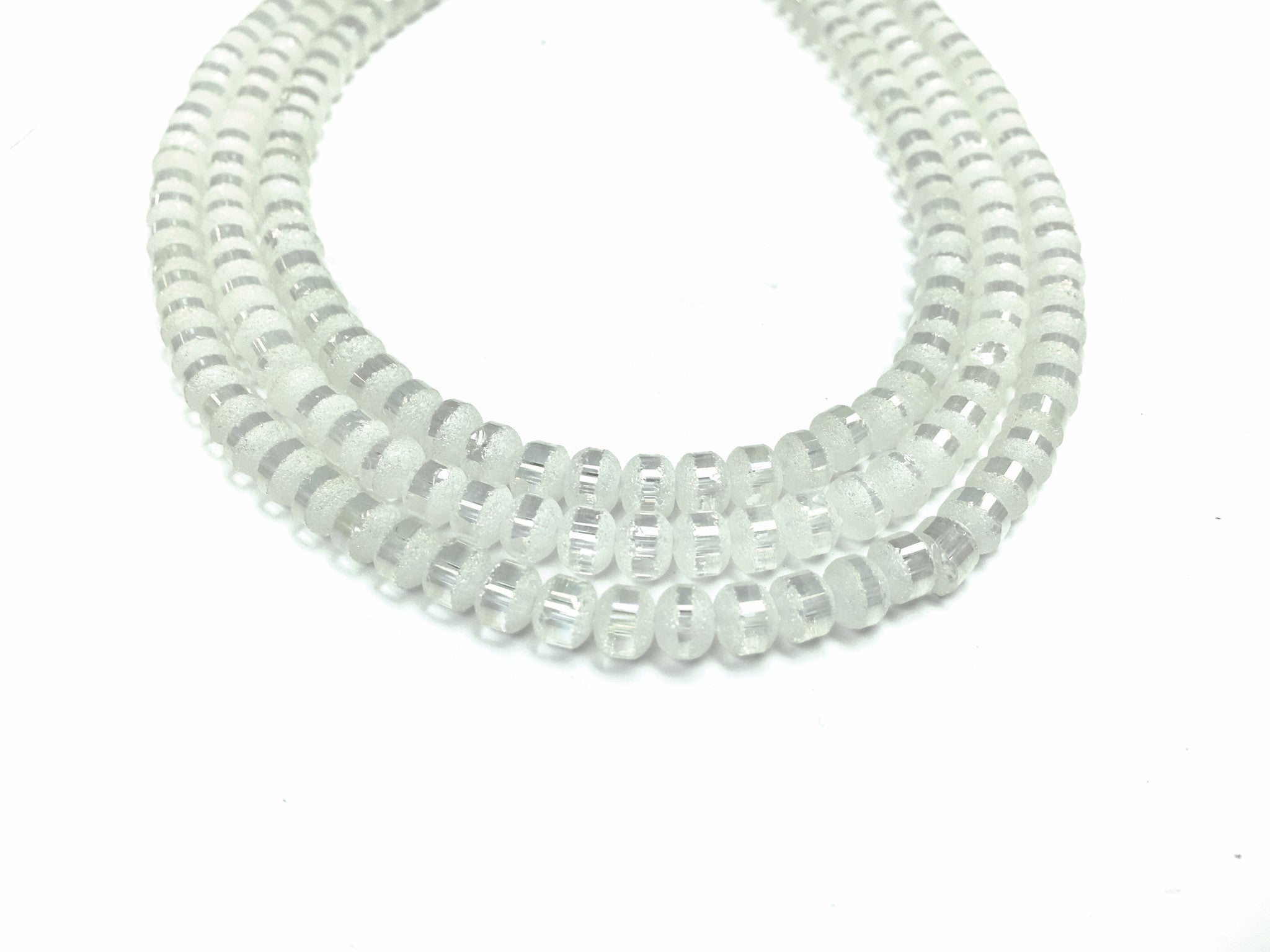 A&SB Crystal Orbits - 7x9mm Pale Matte Striped Rondelle Beads - 16 inch strand