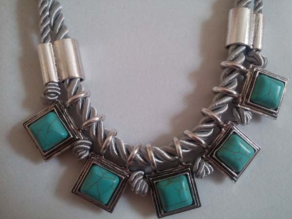 Rhodium plated necklace. Turquoise ceramic detail. Light grey cotton cord. - Honey UK Jewellery and Accessories