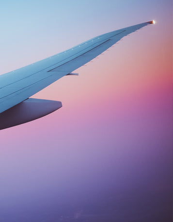 A picture of the end of an airplane wing on a multicolored background.