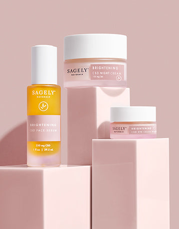 Sagely Naturals Brightening CBD Skincare Collection photographed on pink risers with a pink backdrop