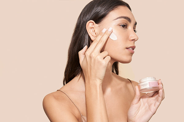 Woman applying Sagely Naturals Brightening CBD Night Cream.