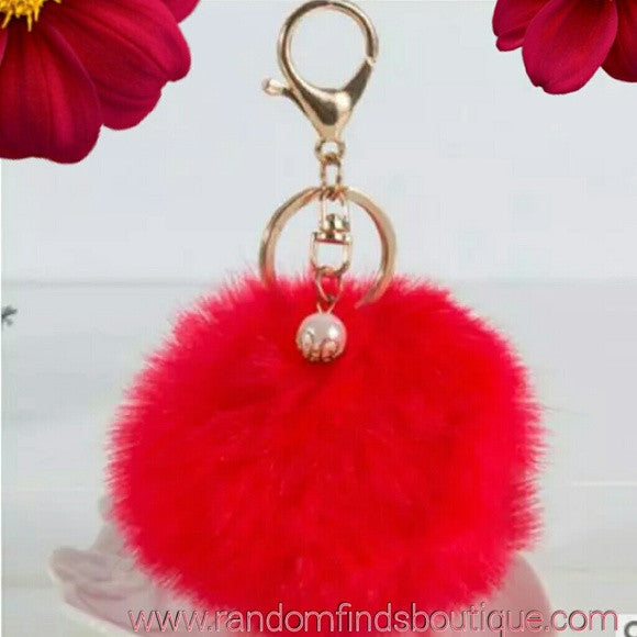 Red pom pom keychain with pearl charm