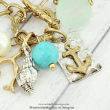 WORN GOLD TONE ANCHOR CHARM CLUSTER TOGGLE BRACELET