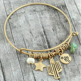 Gold tone cactus star pearl charms bangle bracelet