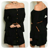Off shoulder black dress with brown buttons and belt