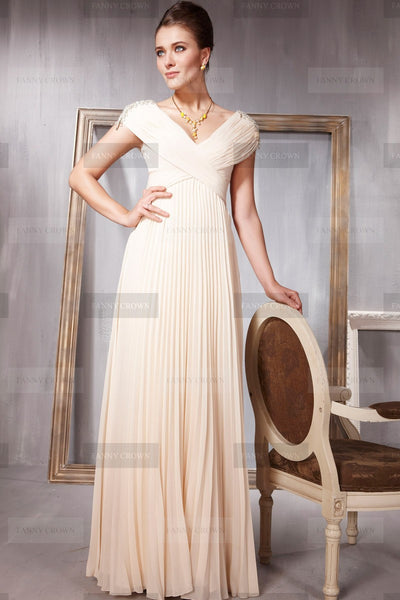 Flattering Champagne dress with embellished shoulders