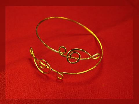 brass bangle bracelet, two treble clefs
