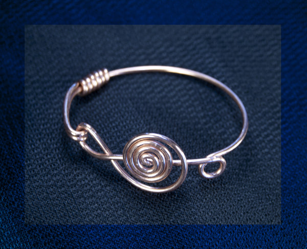 Stylized treble clef bracelet, Copper