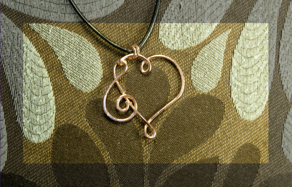 Heart with treble clef pendant and leather necklace, copper