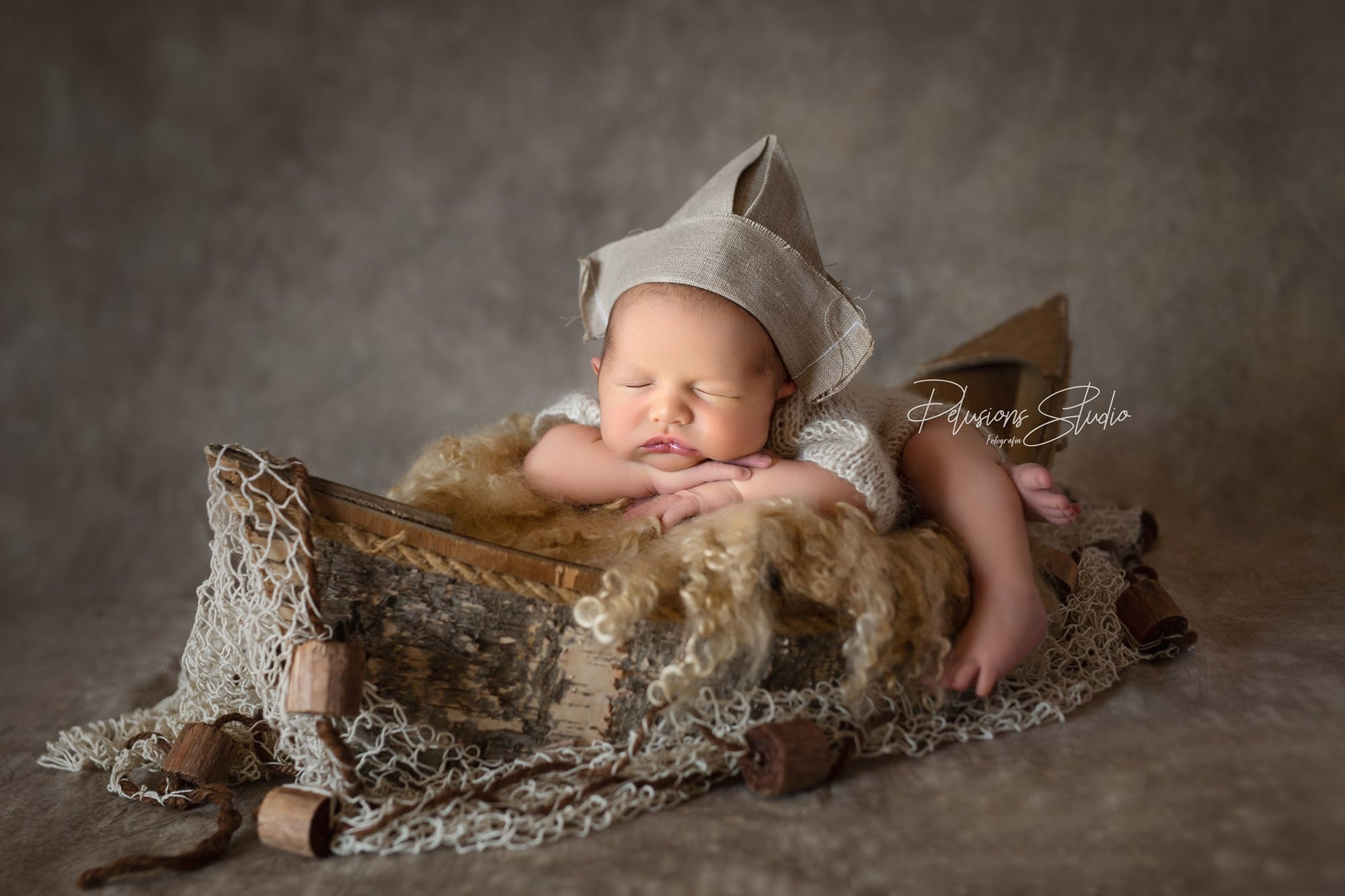 Lovely rustic handmade boat with oars made of wood. Ideal to cradle newborns during your photography shoots.