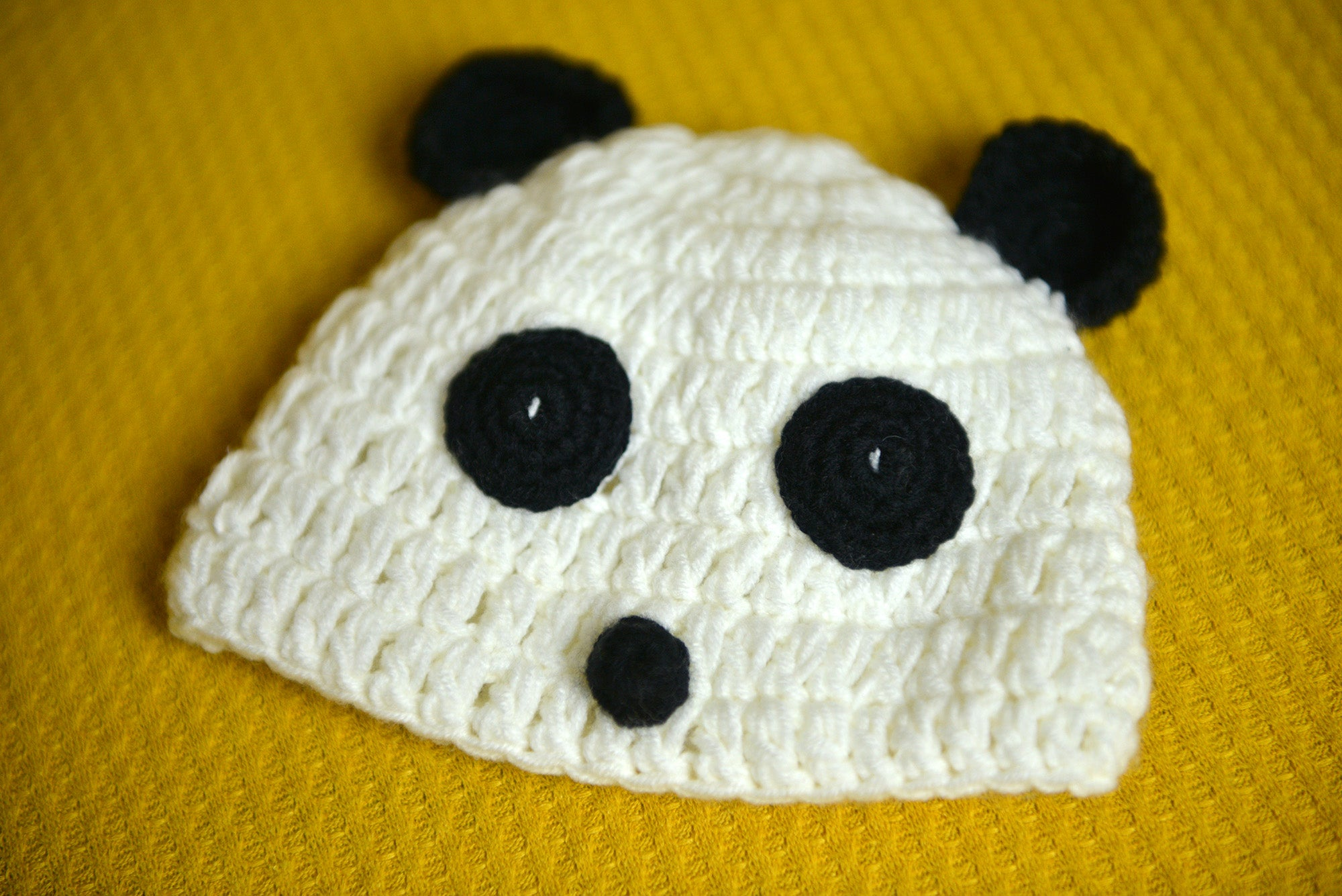 Crochet Panda hat for newborn photography session.