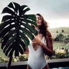 Chelsea Kauai with a giant Monstera leaf in Hawaii