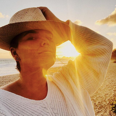 Image of Tahiti Huetter in sunlight with hat on