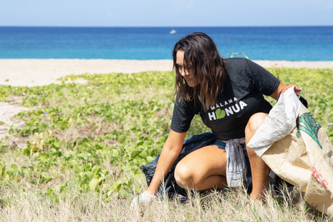 Honua Hawaiian Skincare founder Kapua Browning gathering trash at Makua Beach