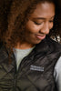 Black quilted puffer vest (womens) - word mark