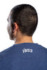 Closeup of detail of the '1853' emblem on back neckline of navy t-shirt