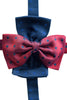 Silk bow ties come in prussian blue and red