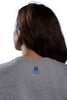 Back of Grey French Terry Dolman showing discrete university logo beneath neckline. Worn by female model