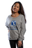 Female model front facing wearing Grey French Terry Dolman with large university logo