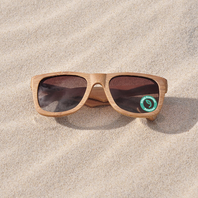 Wooden Sunglasses by Grown on a wood table with keys