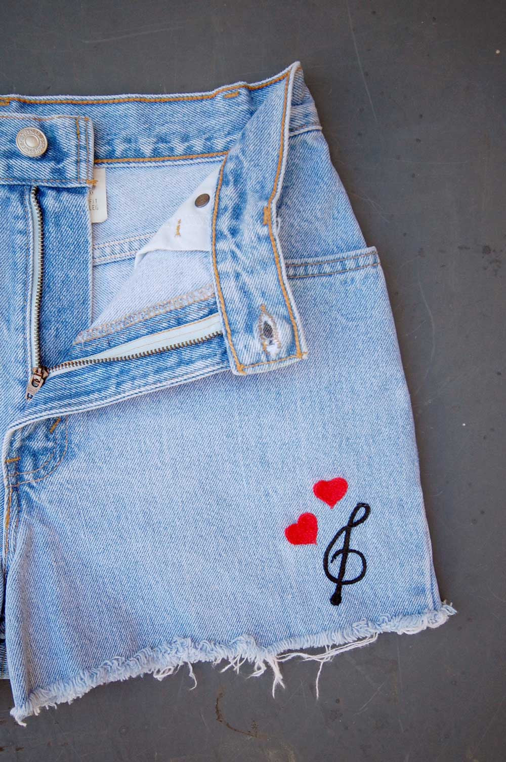 bd22b2b1 Vintage Levi's 505 USA Chain-Stitched Hearts & Music Note Cutoff Denim  Shorts