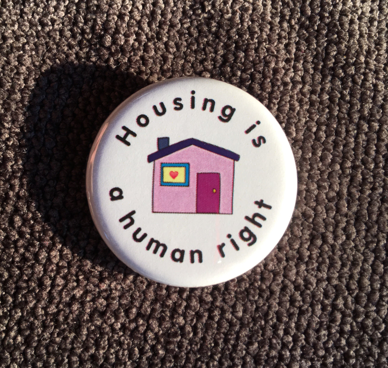Housing is a human right - Radical Buttons