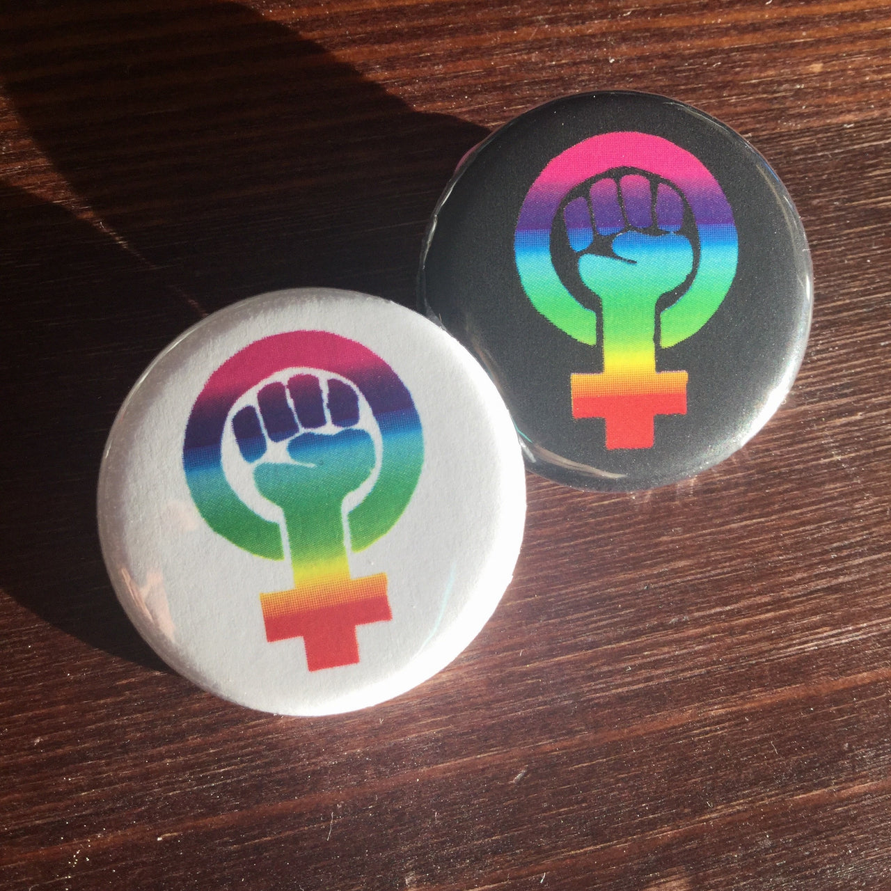 Rainbow black feminism symbol - Radical Buttons