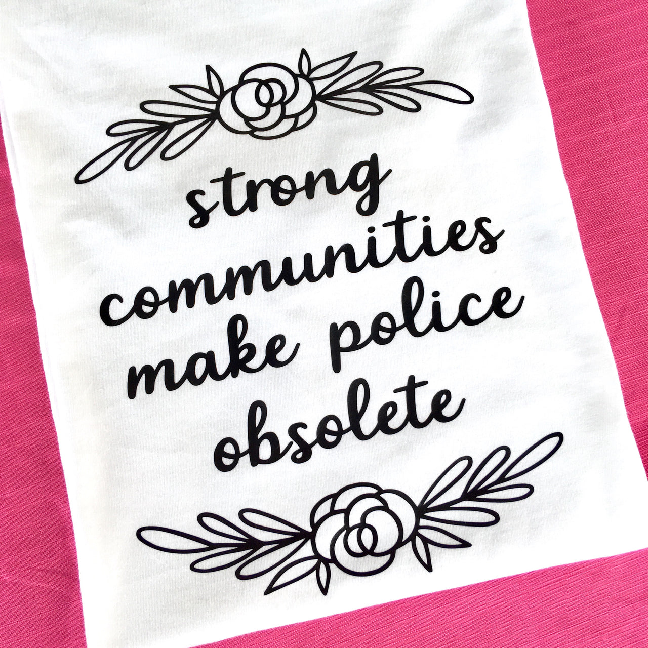 Strong communities make police obsolete (white unisex tee) - Radical Buttons
