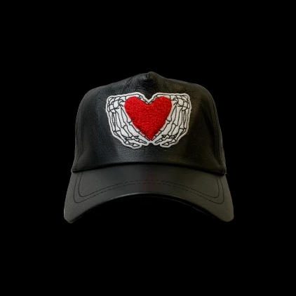 HEARTED HANDS BLACK LEATHER TRUCKER HAT | Accessories | HIP AND BONE