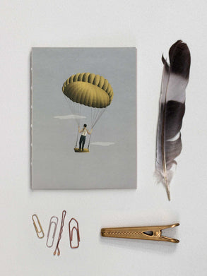 Notebook with man and yellow balloon from ViSSEVASSE