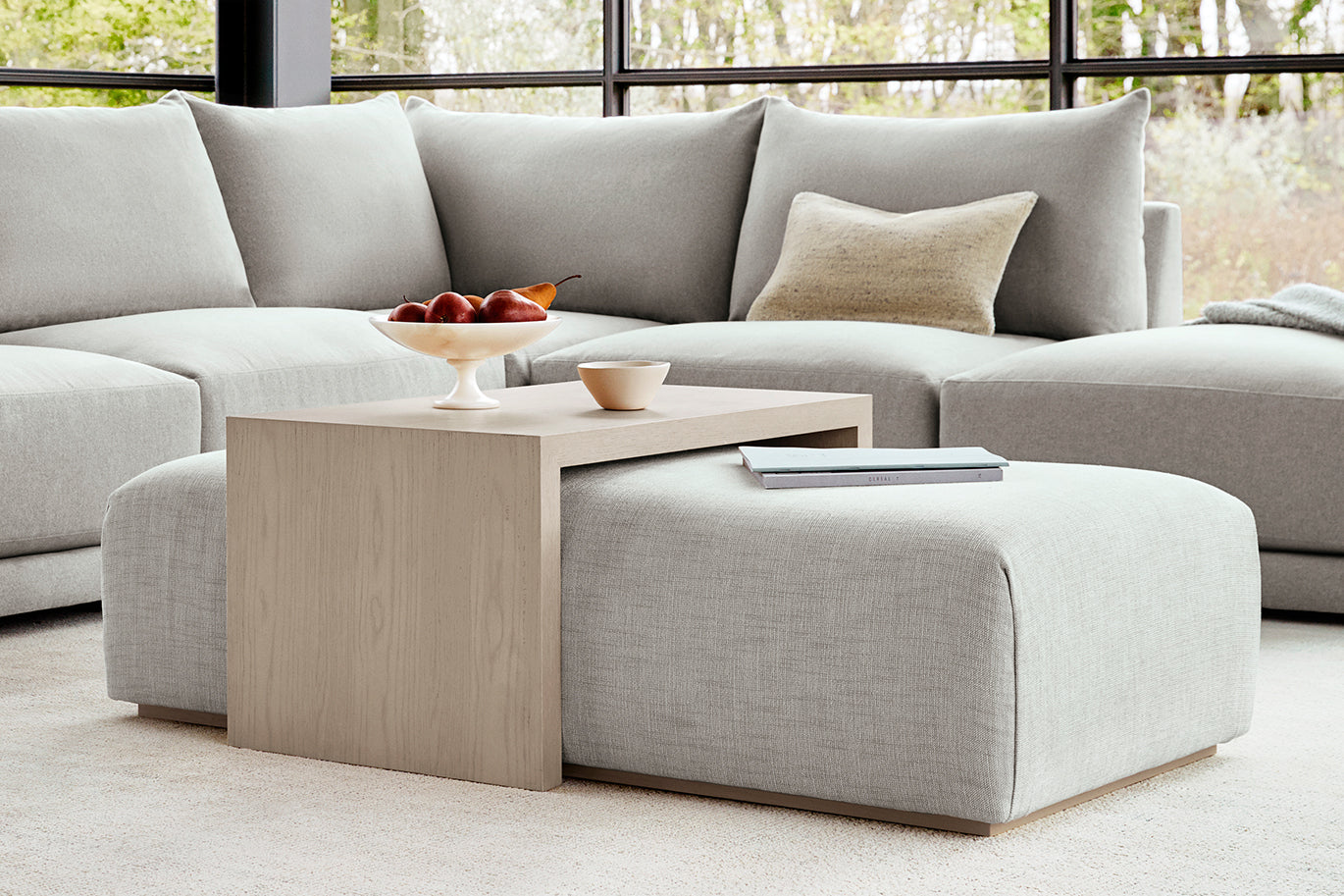 The Bowery Coffee Table Ottoman in Nickel Performance Chenille and White Oak finish