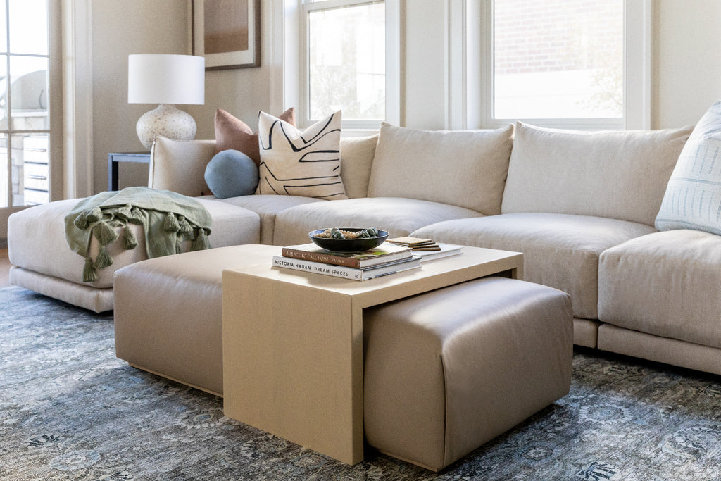 The Bowery Coffee Table Ottoman in Stone Tribeca Leather with White Oak overlay