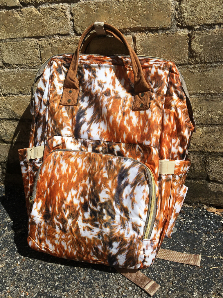 brown cow print backpack diaper bag handbag purse | shop women's clothing clothes apparel accessories and gifts online or in store at boerne pixie boutique | a favorite of locals and san antonio visitors too