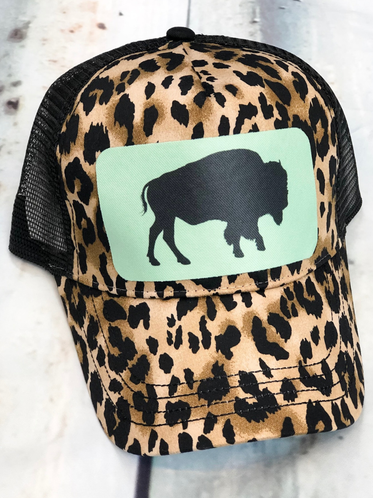 Adjustable leopard print hat with mesh back. Mint green patch features buffalo design. boerne pixie boutique shop online or in store