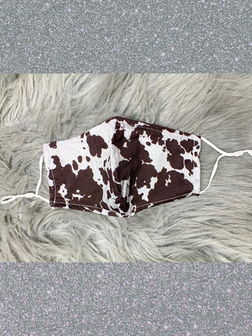 brown and white cow print face mask with filter adjustable straps and metal at nose | shop women's clothing clothes apparel accessories and gifts online or in store at boerne pixie boutique | a favorite of locals and san antonio visitors too