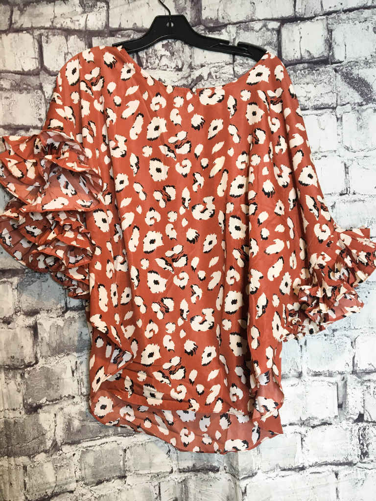 rust orange leopard print floral dolman top with ruffle sleeves shirt blouse | fall and winter fashion | shop women's clothing clothes apparel accessories jewelry and gifts online or in store at boerne pixie boutique | a favorite of locals and san antonio visitors too